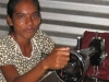 A seamstress hard at work on equipment provided by her Microcredit loan.
